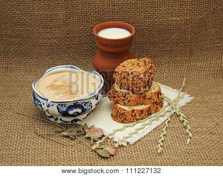 Milk Fermented Baked Milk In Pottery And Bread With Sesame Seeds.