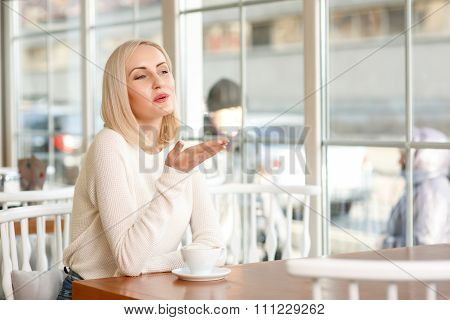 Charming woman sitting in the cafe