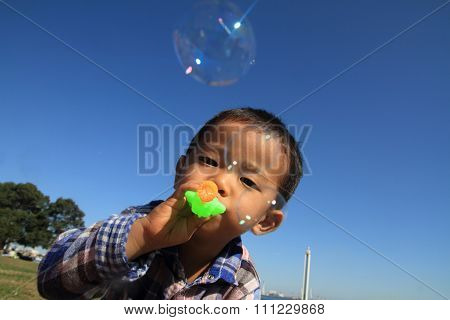Japanese boy playing with bubble (3 years old)