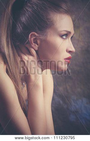 beauty portrait of a young blue eyes woman, studio shot, profile