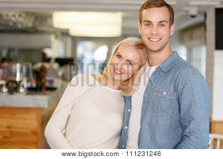 Nice young couple standing in the cafe