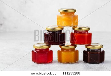 Glass jars with homemade jam Preserved fruits