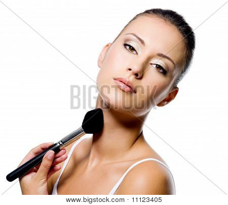 Woman Applying Powder On Neck With Brush