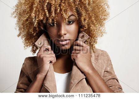 Black Woman Wears Beige Jacket, Curly Hair