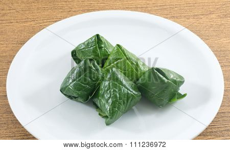 Dish Of Spicy Betel Leaf Wrapped Bite Size Appetizer