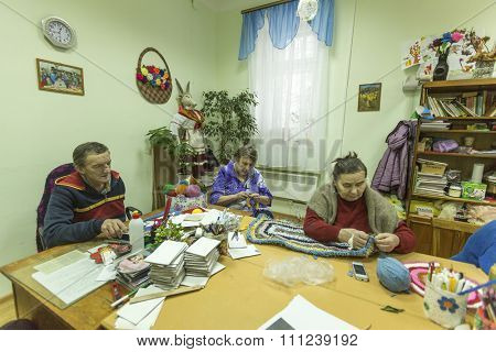 VINNITSY, RUSSIA - CIRCA NOV, 2015: Elderly people during occupational therapy for eldery and disabled in rehabilitation department in Center of social services for pensioners and the disabled.
