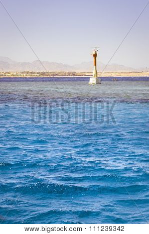 Lighthouse On Reef Shallows, Around The Salt Water Of The Red Sea, Sharm El Sheikh