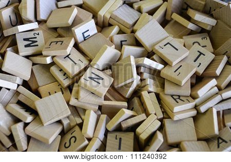 Wooden Lettered Pieces in a Pile
