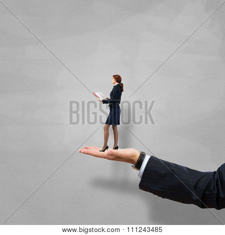 Palm supporting businesswoman