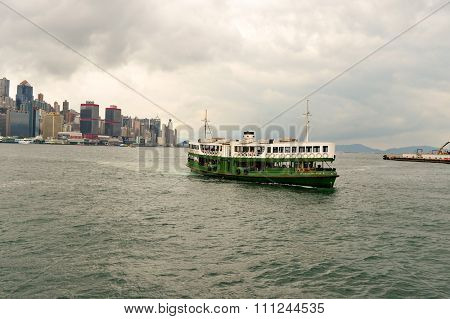 HONG KONG - MAY 06, 2015: A Star Ferry carries passengers across Victoria Harbour. The Star Ferry is a passenger ferry service operator and tourist attraction in Hong Kong