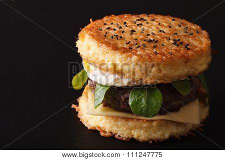 New Ramen Burger Close-up On A Black Background. Horizontal