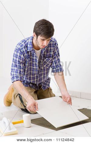 Home Improvement - Handyman Laying Tile