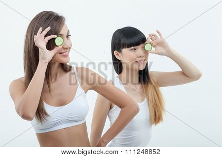 Beautiful two girls are caring of skin
