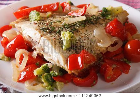 Baked Plaice With Peppers And Broccoli Close-up. Horizontal