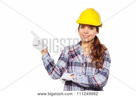 Young Woman In Construction Helmet And Check Shirt