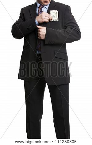 Businessman In Dark Suit Puts A Bunch Of American Dollars Into Jacket Pocket