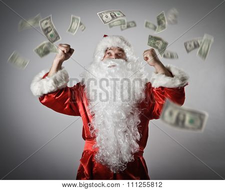 Santa Claus And Dollars. Santa Claus With His Hands Up.