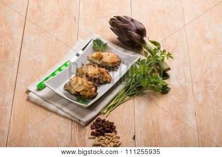 artichoke stuffed with cheese dried grape  and pine nut