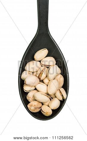Nuts in black spoon