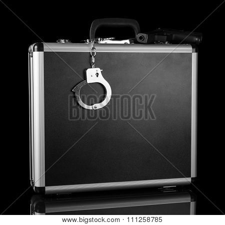 Handcuffs chained to silver case