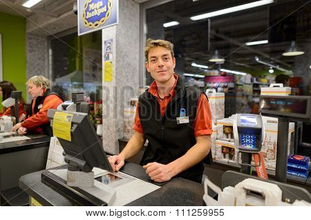 GENEVA, SWITZERLAND - SEPTEMBER 18, 2015: checkout counter in Migros supermarket. Migros is Switzerland's largest retail company, its largest supermarket chain and largest employer