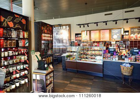 GENEVA, SWITZERLAND - NOVEMBER 18, 2015: interior of Starbucks Cafe. Starbucks Corporation is an American global coffee company and coffeehouse chain based in Seattle, Washington