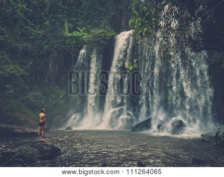 A man at the waterfall, Phnom Koulen at Siem Reap, Cambodia