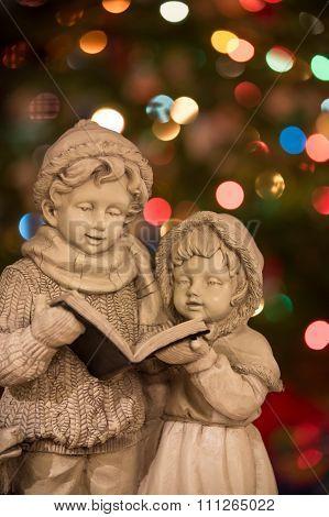 Christmas Carolers With Christmas Lights - Vertical