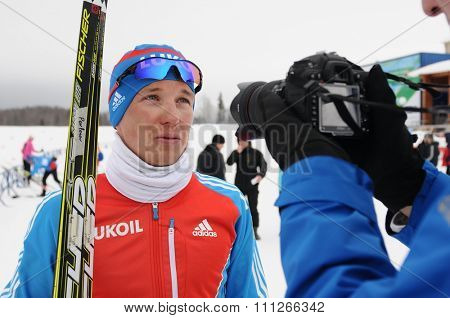 SYKTYVKAR, RUSSIA - APRIL 02, 2013: photographer take photo of skier during the Russian cross-country ski championship-2013. It had been run by Cross-country ski Federation of Russia in Syktyvkar.
