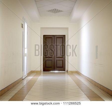 Kiev, Ukraine - July 6, 2015: White Hallway With Marble Floor And Brown Door In Hospital High Contra