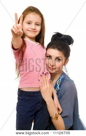Portrait Of Young Mother And Little Daughter. Isolated
