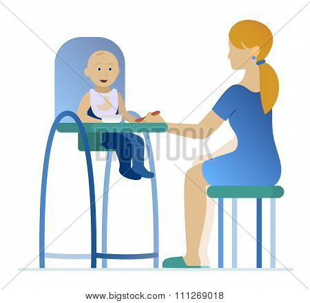 mother feeding a young child in highchair