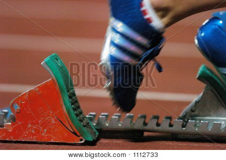 Picture or Photo of Track and field start shoe on the blocks.
