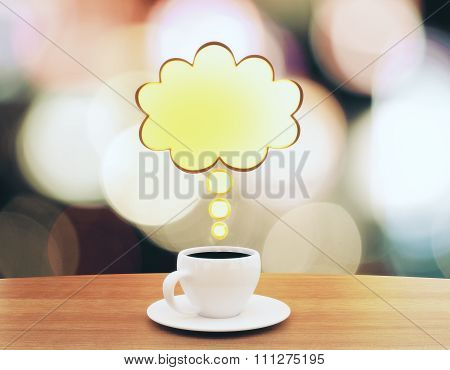 Cup Of Coffee With Speach Bubble On Wooden Table