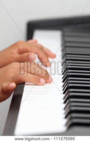 Japanese boy playing a piano (5 years old)