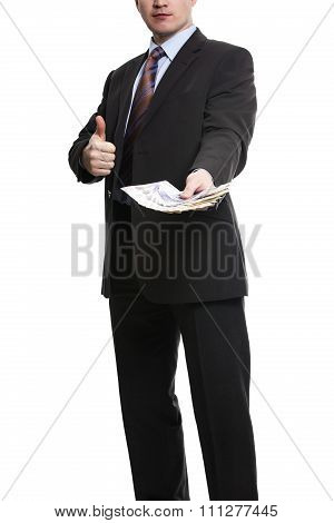 Some Unrecognizable Businessman In Suit Showing A Spread Of Pound Sterling Cash And Thumb Up