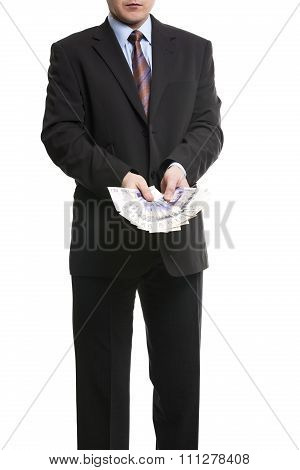 Businessman In Dark Suit With A Bunch Of British Pounds Sterling