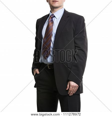Unrecognizable Businessman In Suit Standing With Hand In Pocket