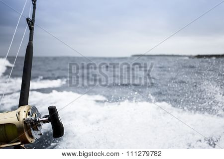 Fishing Rod Above The Splashes Of The Sea