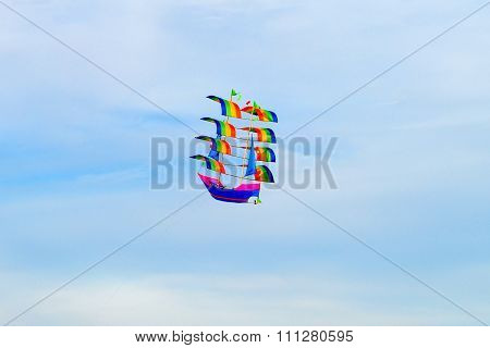 Colorful kite high in the sky