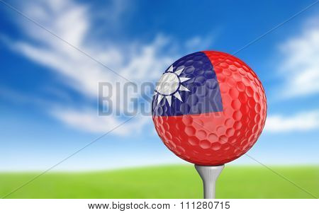 Golf ball with Taiwan flag colors sitting on a tee