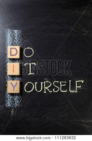 Do It Yourself (DIY), business concept acronym on blackboard