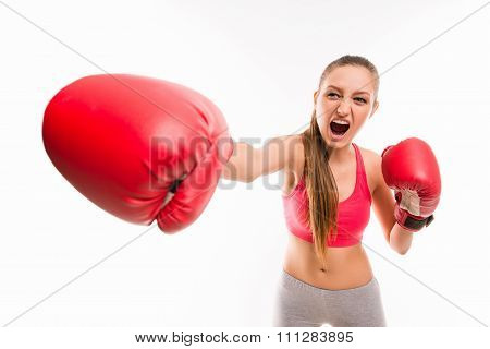A Portrait Of Angry Girl In Boxing Gloves