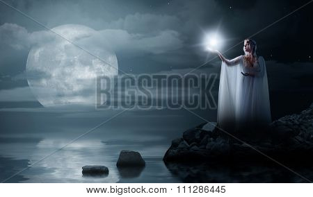 Young elven girl with star isolated on sea coast