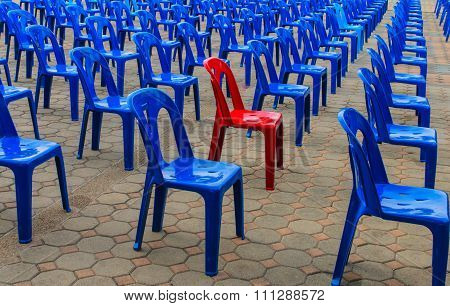 The red chair in many blue chair ,Different chair outstanding