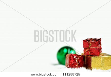 Gold and red Gift box and  green mirror ball