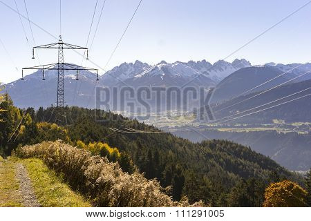 Electricity Pylon Crossing The Alps In Tirol