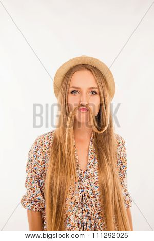 Funny Girl Joking And Making Moustache With Her Hair