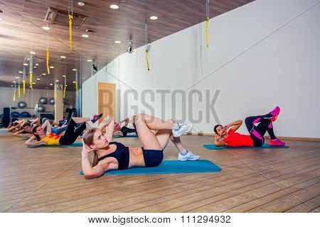 People at the health club with personal trainer, learning correct form