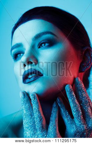 Studio Fashion Portrait Of Attractive Woman With Creative Make-up And Glitter And Spangle On Hands.